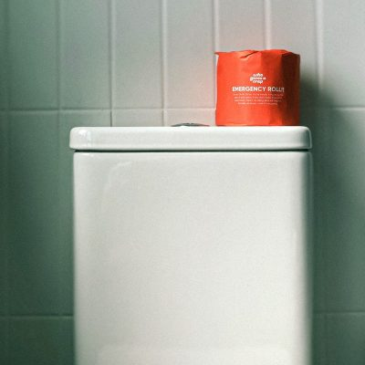wrapped-toilet-paper-on-a-toilet-tank-3944408